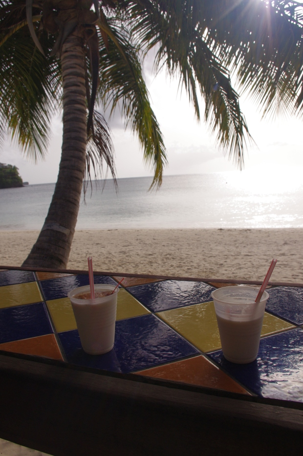 Piña coladas with fresh coconut and nutmeg