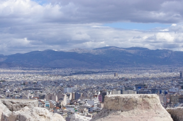 Athens, seen from the Parthenon, sprawls towards the neighboring mountains.